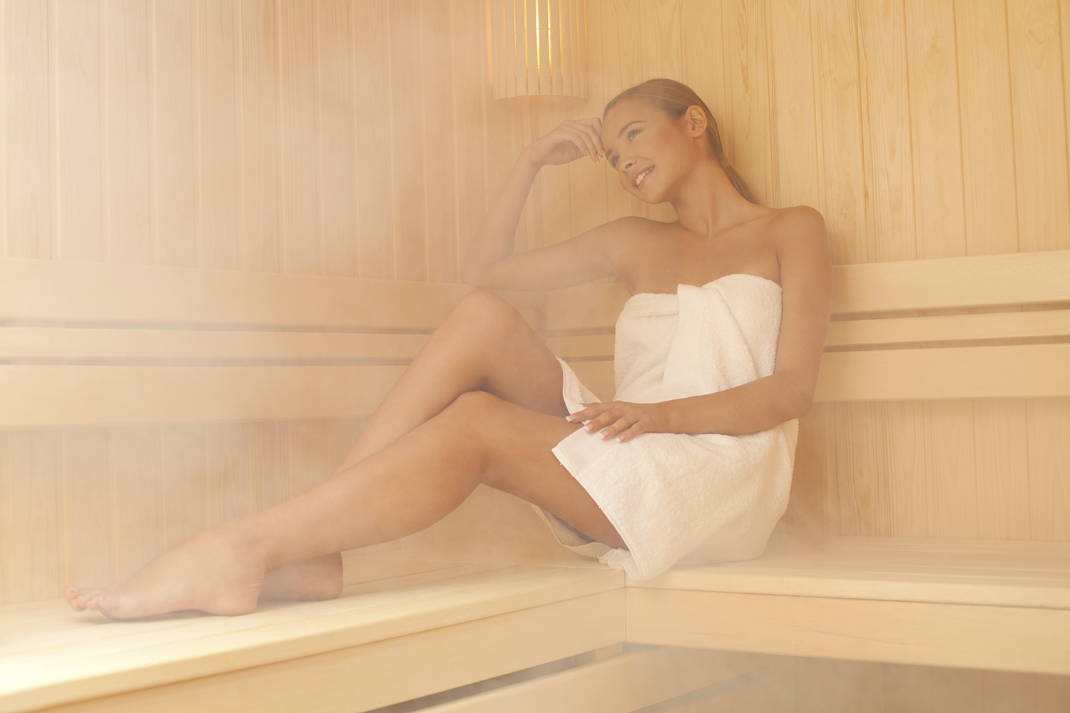Beautiful girl posing in the sauna