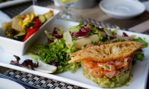 Salmon tartare with avocado, salad, crostini and roasted vegetables