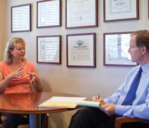 A physician consults with a guest at Canyon Ranch (Tucson, AZ). The spa offers a range of genomic tests including analyzing conditions caused by lifestyle.