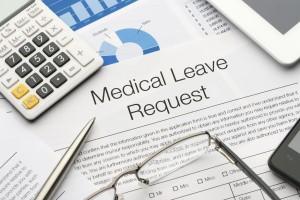 Medical leave request form on a desk.