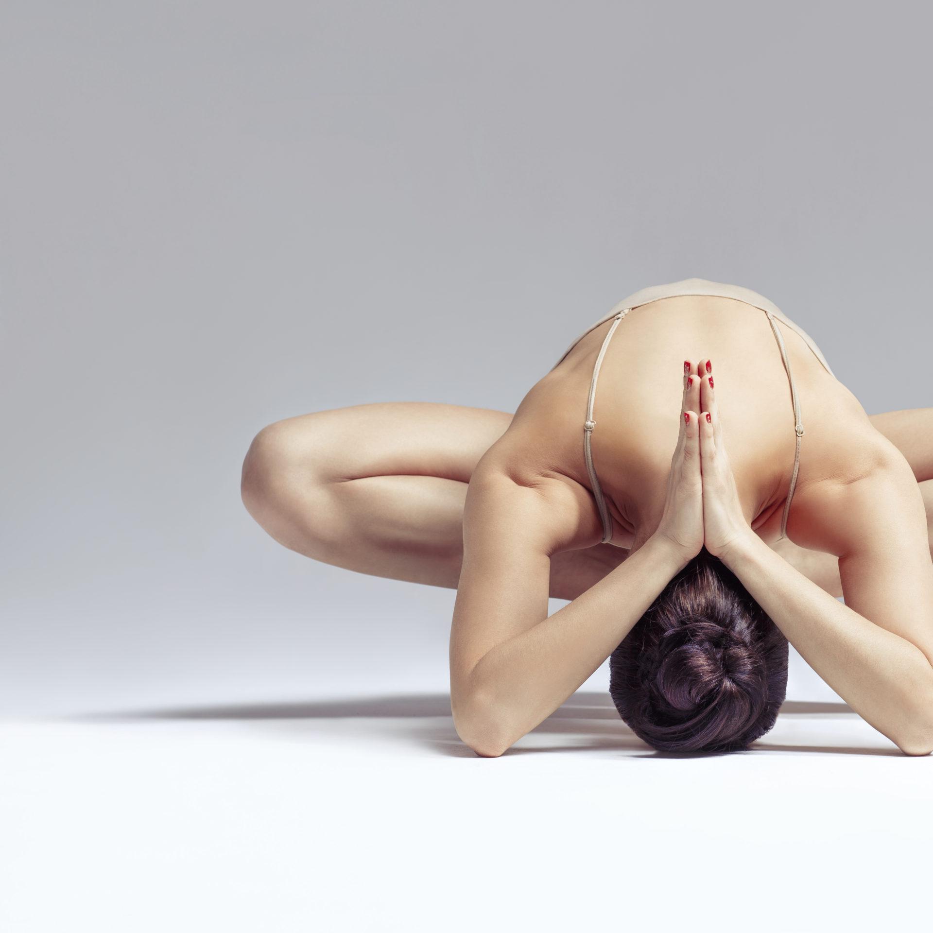 yoga woman posing like a pretzel