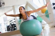 woman balancing on swiss stability balll