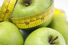 apples and tape measure to illustrate watching weight