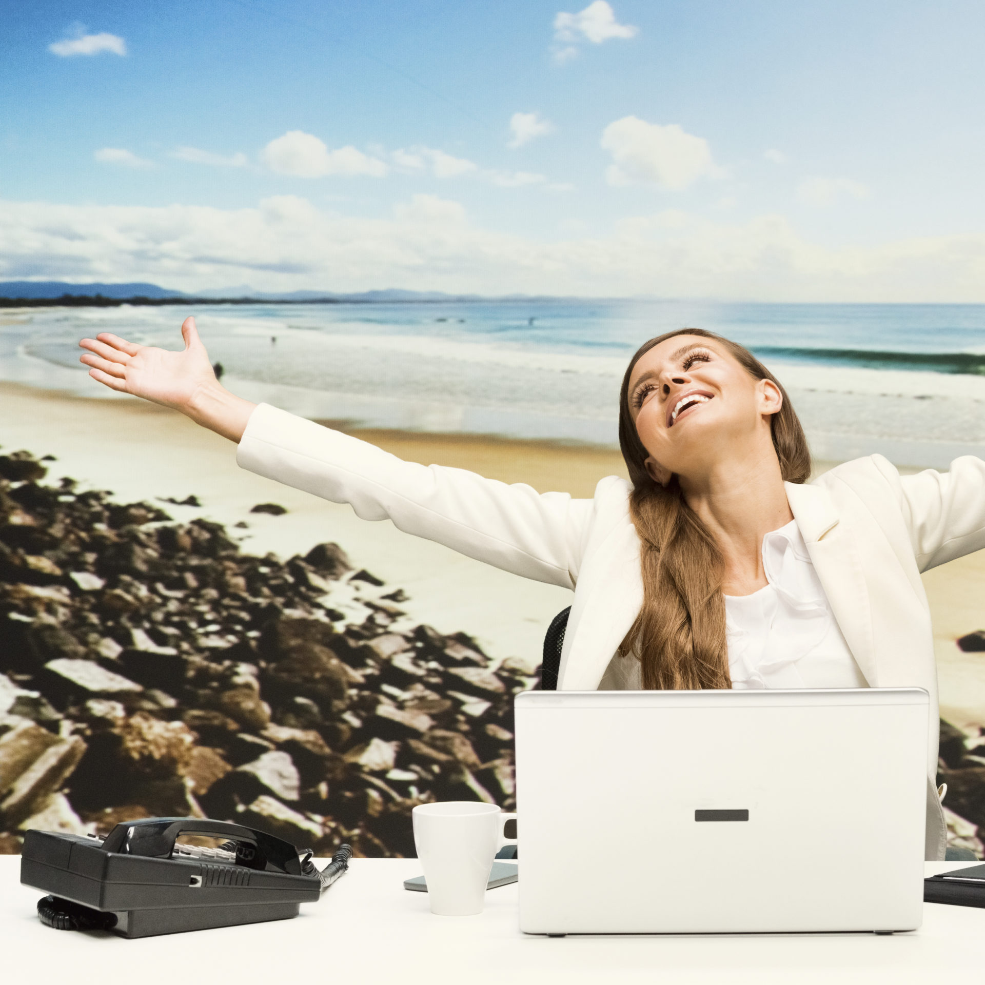 cheerful businesswoman with arms outstretched