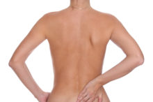 naked woman lower back pain