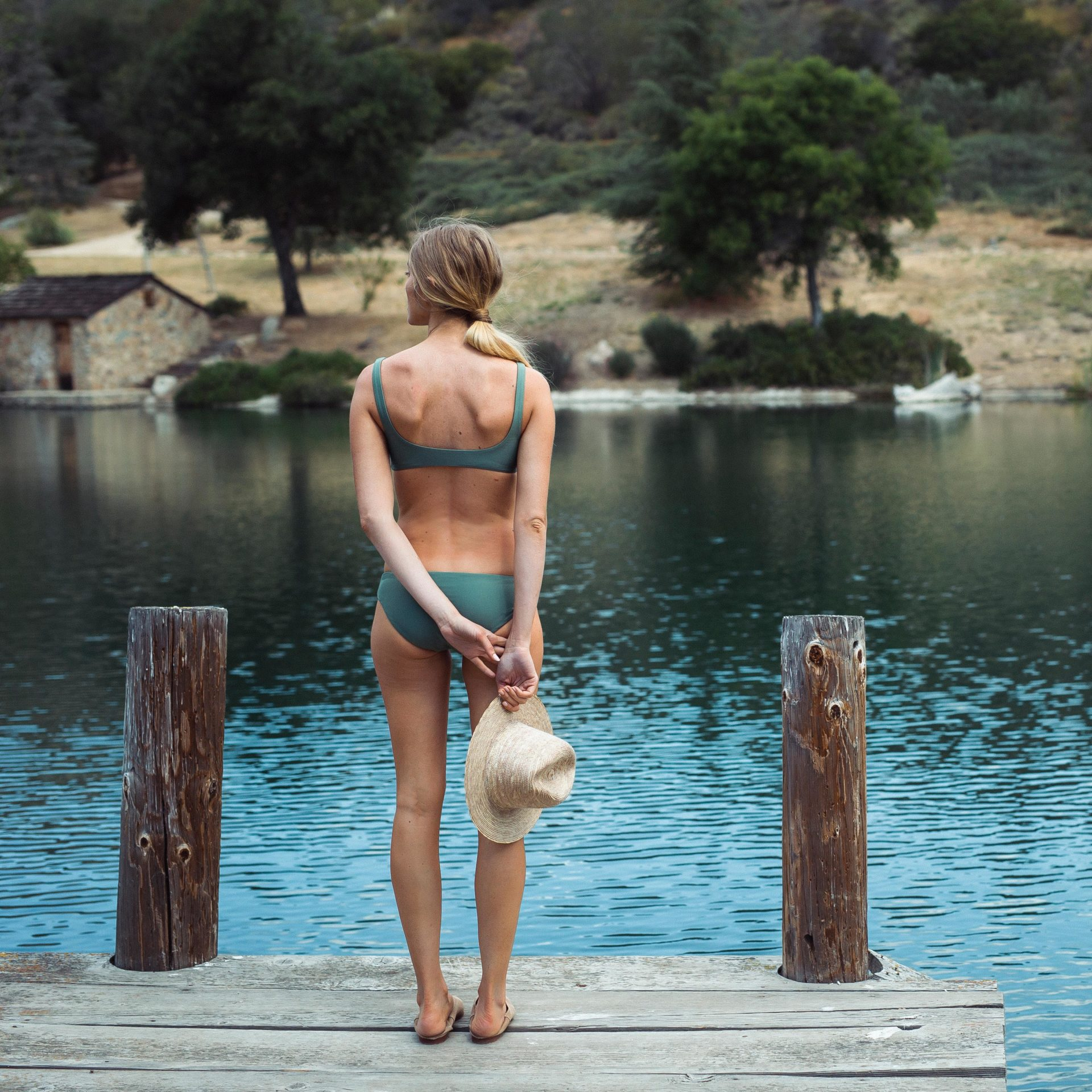 Girl near lake in bikini