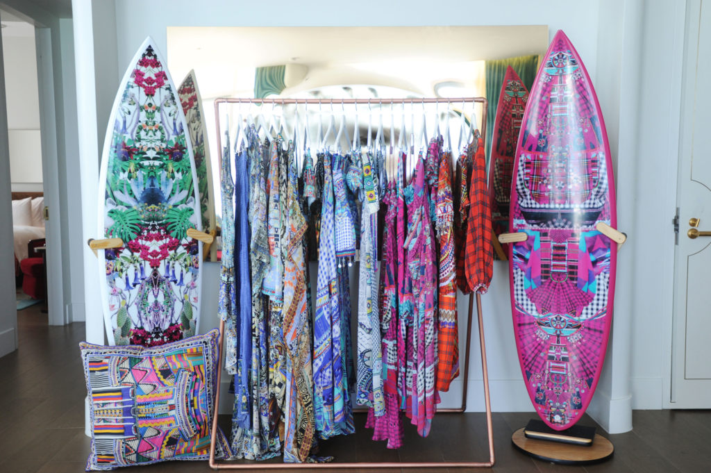 swim week, camilla swimwear, surf boards, and pillows at faena
