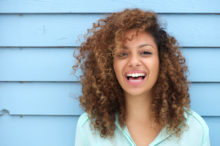 woman smiling curl hai