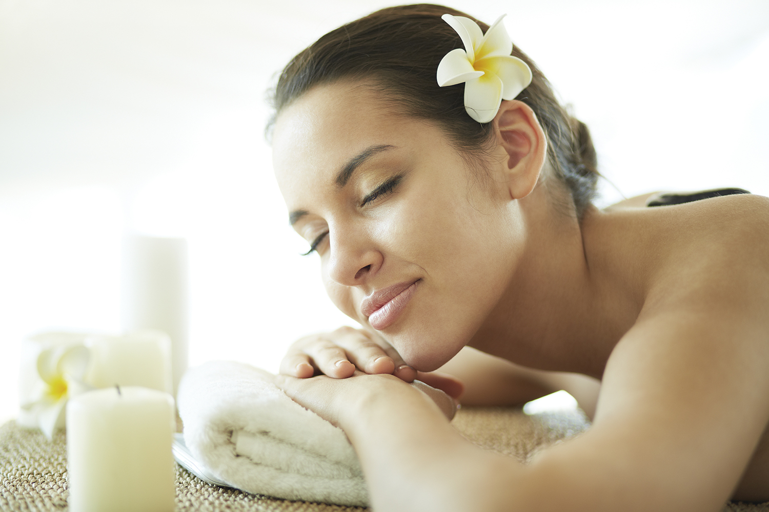 Portrait of young female enjoying procedure of massage